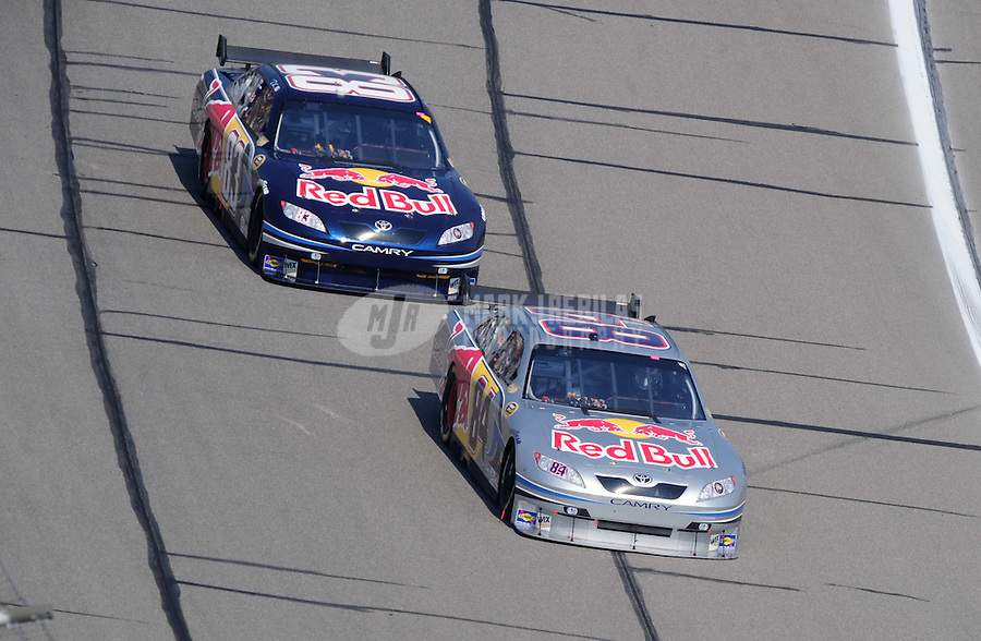 Sept. 28, 2008; Kansas City, KS, USA; Nascar Sprint Cup Series driver A.J. Allmendinger leads teammate Brian Vickers during the Camping World RV 400 at Kansas Speedway. Mandatory Credit: Mark J. Rebilas-