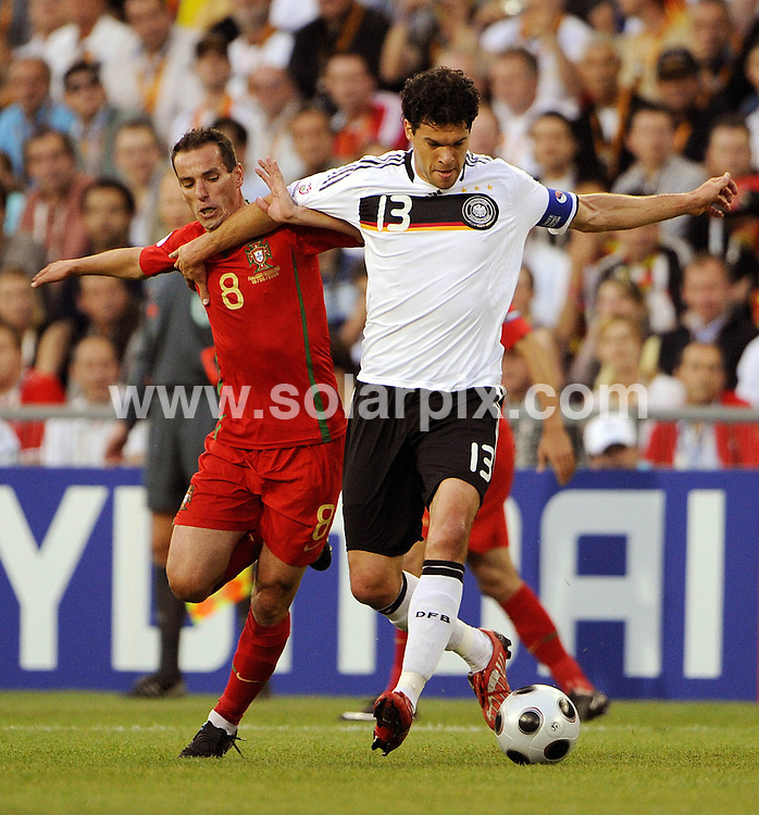**ALL ROUND PICTURES FROM SOLARPIX.COM**.**SYNDICATION RIGHTS FOR UK AND SPAIN ONLY**.Euro 2008 European Football Championship being held in Austria/Switzerland. Quarter Final, match 25, Portugal vs Germany, at the St. Jakob Park Stadium, Basel, Switzerland. 19th June 2008 ..This pic: Petit and Michael Ballack..JOB REF: 6690 CPR/Torsten Silz.DATE: 19_06_2008.**MUST CREDIT SOLARPIX.COM OR DOUBLE FEE WILL BE CHARGED* *UNDER NO CIRCUMSTANCES IS THIS IMAGE TO BE REPRODUCED FOR ANY ONLINE EDITION WITHOUT PRIOR PERMISSION*