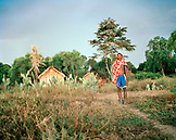 MADAGASCAR, young man standing in field, portrait, Mahazoarivo Village