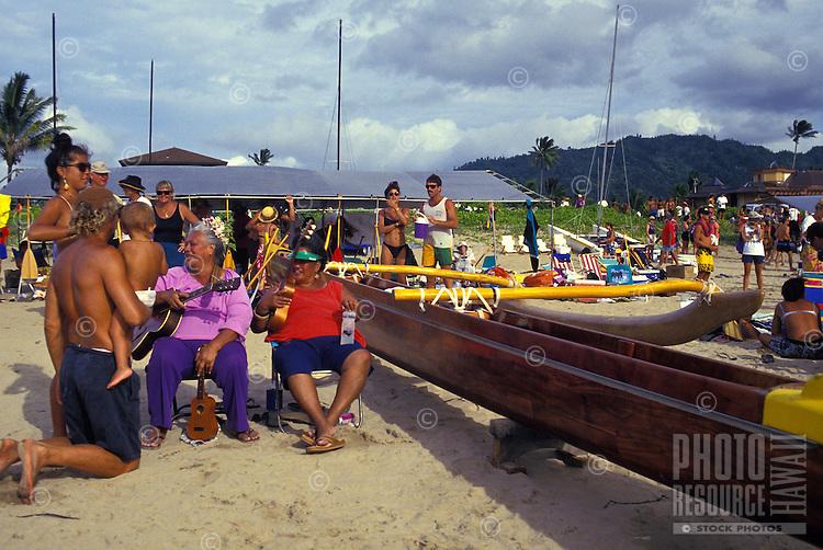EDITORIAL ONLY. Enjoying an outrigger canoe regatta, Hanalei, Kauai