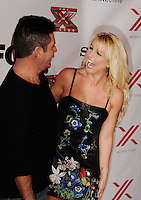 LOS ANGELES, CA - DECEMBER 06: Simon Cowell and Britney Spears arrive at the 'The X Factor' Viewing Party Sponsored By Sony X Headphones at Mixology101 & Planet Dailies on December 6, 2012 in Los Angeles, California.PAP1212JP346.PAP1212JP346.PAP1212JP346.
