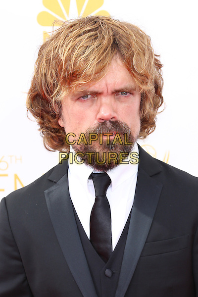 LOS ANGELES, CA - AUGUST 25: Peter Dinklage at The 66th Primetime Emmy Awards held at Nokia Theater L.A. LIVE in Los Angeles, CA on August 25, 2014.  <br /> CAP/MPI/mpi99<br /> &copy;mpi99/MediaPunch/Capital Pictures