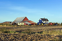 Colorful barn, tractors and farm house, Vergennes, Vermont, USA.