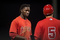 AZL Angels right fielder D'Shawn Knowles (20) talks to manager Jack Santora (5) between innings of an Arizona League game against the AZL Diamondbacks at Tempe Diablo Stadium on June 27, 2018 in Tempe, Arizona. AZL Angels defeated the AZL Diamondbacks 5-3. (Zachary Lucy/Four Seam Images)