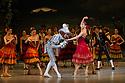 London, UK. 30.03.2013. The Mikhailovsky Ballet present DON QUIXOTE at the London Coliseum. Picture shows: Pavel Maslennikov (Gameche) and Natalia Osipova (Kitri). © Jane Hobson.