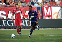 Manchester United midfielder Nani (17) dribbles in for the shot as Chicago Fire defender Gonzalo Segares (13) looks on.  Manchester United defeated the Chicago Fire 3-1 at Soldier Field in Chicago, IL on July 23, 2011.