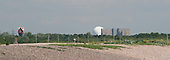 """Looking towards Thorpeness and seeing Sizewell """"A"""" (the block) and """"B"""" (the sphere) Nuclear Power Station, Suffolk coast, UK."""