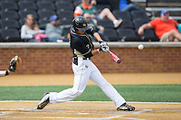 Bruce Steel (17) of the Wake Forest Demon Deacons makes contact with the baseball during the game against the Miami Hurricanes at Wake Forest Baseball Park on March 22, 2015 in Winston-Salem, North Carolina.  The Demon Deacons defeated the Hurricanes 10-4.  (Brian Westerholt/Four Seam Images)