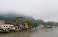 The town Tournon across the Rhone river with the Chateau de Tournon. under snow in seasonably exceptional weather in April 2005. In the distance, the ruin of a tower. Tain l'Hermitage, Drome, Drôme, France, Europe
