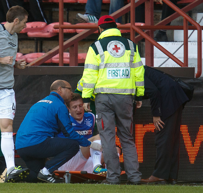 Dorin Goian down with an injury with physio Pip Yeates and doctor Paul Jackson