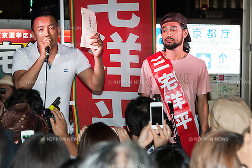 (L to R) Japanese politician and former actor Taro Yamamoto and Yohei Miyake musician and independent candidate for July's House of Councillors elections, campaign outside Shinjuku Station on June 26, 2016, Tokyo, Japan. Yamamoto came to support the Miyake's independent election campaign for the next July's House of Councillors elections. (Photo by Rodrigo Reyes Marin/AFLO)