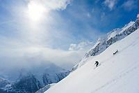 Idalgo and his dog, down Pizzo Pesciora, Val Bedretto, Ticino, Switzerland, February 2013.