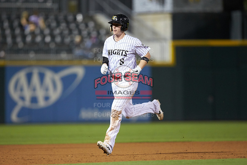 Zack Collins (8) of the Charlotte Knights rounds the bases after hitting his second home run of the game against the Scranton/Wilkes-Barre RailRiders at BB&T BallPark on August 14, 2019 in Charlotte, North Carolina. The Knights defeated the RailRiders 13-12 in ten innings. (Brian Westerholt/Four Seam Images)