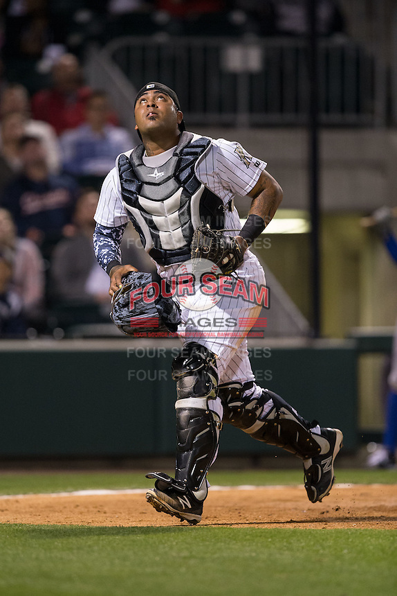 Charlotte Knights catcher Hector Sanchez (29) tracks a pop fly during the game against the Durham Bulls at BB&T BallPark on April 14, 2016 in Charlotte, North Carolina.  The Bulls defeated the Knights 2-0.  (Brian Westerholt/Four Seam Images)