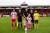 The two captains line up with the mascots pre-match during Stevenage vs Norwich City, Friendly Match Football at the Lamex Stadium on 11th July 2017