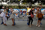 "July 16, 2014, Tokyo, Japan - People take themselves pictures in front of the Doraemon statues at Roppongi Hills on July 16, 2014. Sixty-six different statues of popular Japanese cartoon character Doraemon are lined up in front of the Mori Tower as a part of TV Asahi's ""Summer Station"" activities which will held from July 19 to August 24. (Photo by Rodrigo Reyes Marin/AFLO)"