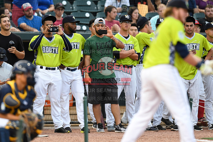 Merandy Gonzalez and Ali Sanchez take video of Dash Winningham of the Columbia Fireflies as he participates in the Home Run Derby as part of of the South Atlantic League All-Star Game festivities on Monday, June 19, 2017, at Spirit Communications Park in Columbia, South Carolina. (Tom Priddy/Four Seam Images)