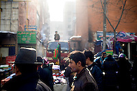 Uighurs walk through the Uighur section of Urumqi, Xinjiang, China. The city is divided between Han and Uighur ethnicities, and violent clashes erupted between the groups in 2009.