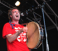 R&oacute;n&aacute;n &Oacute;' Snodaigh.<br /> Irish musician, poet and lead singer with the band Kila.<br /> WOMAD Festival, Reading, England, July 2004