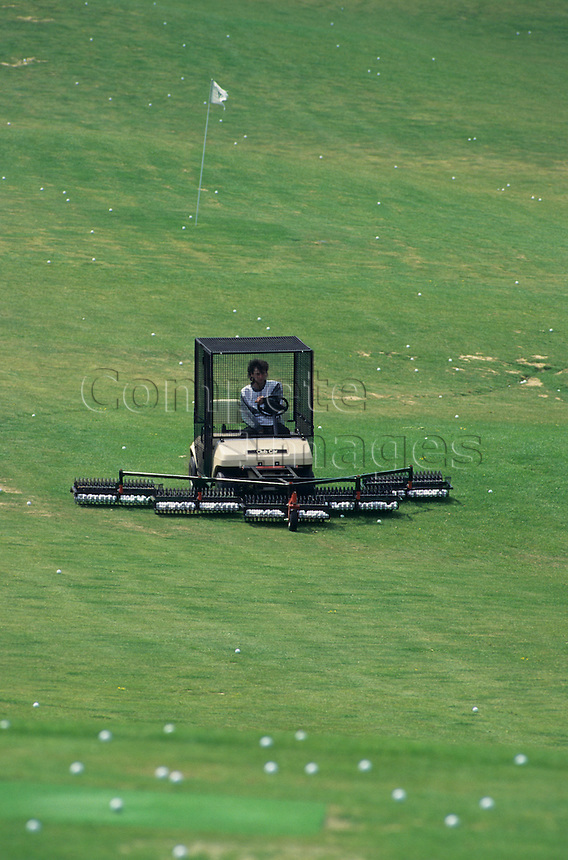 Mechanised golf ball collector on the practice tee