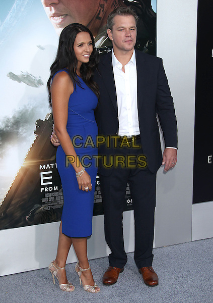 Luciana Barroso, Matt Damon<br /> &quot;Elysium&quot; Los Angeles Premiere held at the Regency Village Theatre, Westwood, California, UK,<br /> 7th August 2013.<br /> full length dress smiling  blue navy suit white shirt dress married couple husband wife <br /> CAP/ADM/RE<br /> &copy;Russ Elliot/AdMedia/Capital Pictures