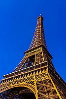 A low angle view of the Eiffel Tower, the world famous wrought-iron lattice tower that is the most famous landmark of Paris, France.