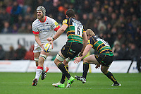 20121027 Copyright onEdition 2012©.Free for editorial use image, please credit: onEdition..Alistair Hargreaves of Saracens passes before he is tackled by Phil Dowson of Northampton Saints during the Aviva Premiership match between Northampton Saints and Saracens at Franklin's Gardens on Saturday 27th October 2012 (Photo by Rob Munro)..For press contacts contact: Sam Feasey at brandRapport on M: +44 (0)7717 757114 E: SFeasey@brand-rapport.com..If you require a higher resolution image or you have any other onEdition photographic enquiries, please contact onEdition on 0845 900 2 900 or email info@onEdition.com.This image is copyright the onEdition 2012©..This image has been supplied by onEdition and must be credited onEdition. The author is asserting his full Moral rights in relation to the publication of this image. Rights for onward transmission of any image or file is not granted or implied. Changing or deleting Copyright information is illegal as specified in the Copyright, Design and Patents Act 1988. If you are in any way unsure of your right to publish this image please contact onEdition on 0845 900 2 900 or email info@onEdition.com