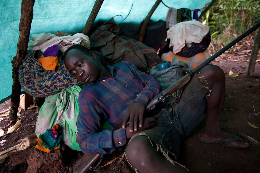 23 may 2010 - Western Equatoria State, South Sudan - People displaced by the LRA settle near Tambura. A spate of continuing LRA attacks in Western Equatoria State has pushed thousands of families to flee from their village to larger towns to seek protection. Many villagers carry machetes or weapons for self-defense since the attacks. Western Equatoria state has been rocked by LRA activities since 2006. Western Equatoria state has been rocked by LRA activities since 2006. Photo credit: Benedicte Desrus