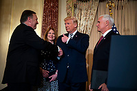 United States President Donald J. Trump shakes hands with Mike Pompeo, U.S. secretary of state, after Pompeo is sworn in by Vice President Mike Pence, as Susan Pompeo looks on, at the State Department, in Washington, D.C., U.S., on Wednesday, May 2, 2018. <br /> Credit: Al Drago / Pool via CNP /MediaPunch