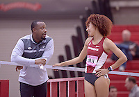 NWA Democrat-Gazette/BEN GOFF @NWABENGOFF<br /> Chris Johnson, Arkansas assistant coach, talks with Taliyah Brooks of Arkansas after she ran in the 60 meter hurdles prelims Friday, Feb. 10, 2017 during the Tyson Invitational at the Randal Tyson Track Complex in Fayetteville.