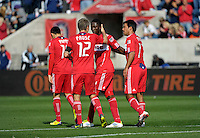 Chicago forward Patrick Nyarko (14) gets a pat on the head from teammate Logan Pause (12) after scoring the Fire's third goal.  The Chicago Fire defeated the New England Revolution 3-2 at Toyota Park in Bridgeview, IL on Sept. 25, 2011.