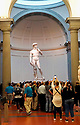 Tourists crowd to get a look at Michelangelo's sculpture of David.  Half of our group decided to visit Michelangelo's David one morning in Florence.  It was a guided audio tour filled with history Michelangelo while seeing many of his actual sculptures.