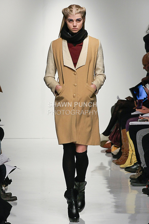 Model walks runway in an outfit from the 4 Corners Of a Circle Fall 2013 collection fashion show, by Natsuko Kanno, on February 7, 2013 during New York Fashion Week Fall 2013.