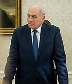 "White House Chief of Staff John Kelly looks on as United States President Donald J. Trump makes remarks prior to signing S. 3508, the ""Save Our Seas Act of 2018"" in the Oval Office of the White House in Washington, DC on Thursday, October 11, 2018.  <br /> Credit: Ron Sachs / CNP"
