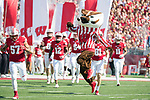 Wisconsin Badgers mascot Bucky Badger leads the team onto the field prior to an NCAA College Football game against the Florida Atlantic Owls Saturday, September 9, 2017, in Madison, Wis. The Badgers won 31-14. (Photo by David Stluka)