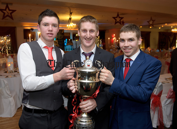 Conor Downes, Patrick Foley and Declan Keniry at the Naomh Eoin victory social and 40th anniversary celebrations in the Armada Hotel, Spanish Point. Photograph by John Kelly.
