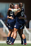 15 September 2013: Notre Dame's Morgan Andrews (center) celebrates her goal with Cari Roccaro (5) and Lauren Bohaboy (9). The University of North Carolina Tar Heels hosted the University of Notre Dame Fighting Irish at Fetzer Field in Chapel Hill, NC in a 2013 NCAA Division I Women's Soccer match. Notre Dame won the game 1-0.