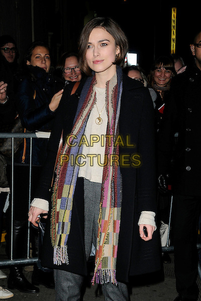 "KEIRA KNIGHTLEY .Seen leaving after the evening performance of ""The Children's Hour"", The Comedy Theatre, London, England, UK, February 8th 2011..half length black coat scarf gold necklace patchwork green pink blue gold grey gray trousers .CAP/CAN.©Can Nguyen/Capital Pictures."
