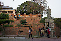 Tourists take pictures of a statue of Zheng Chenggong, also known as Koxinga, or Coxinga at Anping Fort in Tainan, Taiwan, 2015. Zheng was a pirate leader of Ming forces against the Manchu conquerors of China and best known for establishing Chinese control over Taiwan. Anping Fort used to be called Fort Zeelandia which was a fortress built over ten years from 1624 to 1634 by the Dutch East India Company (VOC), in the town of Anping (Tainan) on the island of Formosa (present-day Taiwan), during their 38-year rule over the western part of that island.