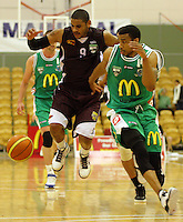 Heat guard Corey Webster (left) pounces back to regain possession from Jets import Daryl Hudson during the NBL match between Manawatu Jets and Harbour Heat at Arena Manawatu, Palmerston North, New Zealand on Saturday 17 April 2010. Photo: Dave Lintott / lintottphoto.co.nz