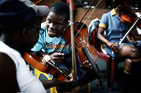 SOWETO, SOUTH AFRICA OCTOBER 25: Members of a string orchestra rehearse in a community hall in Pimville Community center on October 25, in Soweto, Johannesburg, South Africa. About fifty boy and girls play string instruments a few times a week and they sometimes perform in the township. Soweto is South Africa&rsquo;s largest township and it was founded about one hundred years to make housing available for black people south west of downtown Johannesburg. The estimated population is between 2-3 million. Many key events during the Apartheid struggle unfolded here, and the most known is the student uprisings in June 1976, where thousands of students took to the streets to protest after being forced to study the Afrikaans language at school. Soweto today is a mix of old housing and newly constructed townhouses. A new hungry black middle-class is growing steadily. Many residents work in Johannesburg, but the last years many shopping malls have been built, and people are starting to spend their money in Soweto.  <br /> (Per-Anders Pettersson)