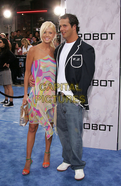 "TARA REID.Attends Twentieth Century Fox's World Premiere of ""I, Robot"" held at The Mann's Village Theatre in Westwood,.California, July 7th 2004..full length pucci style silk dress orange and green open toe strappy high heels shoes.*UK sales only*.www.capitalpictures.com.sales@capitalpictures.com.©Capital Pictures"