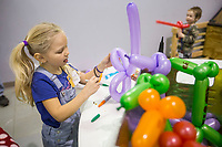 Violet Yamaji, 6, makes a balloon sword Tuesday, Feb. 11, 2020, during the Social Homeschoolers Network annual Junior Entrepreneur Fair at Rogers Christian Church. Violet and her sister Venessa, 8, created the business Balloon Buddies and sold the swords and a variety of balloon animals. Pre-kindergarten through high school students in the group created businesses and sold their home-made products and services to the public during the fair. Judges also awarded prizes to the best businesses by age group. Check out nwaonline.com/200212Daily/ for today's photo gallery.<br /> (NWA Democrat-Gazette/Ben Goff)