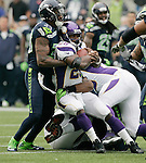 Minnesota Vikings running back Adrian Peterson is stopped after a short gain by Seattle Seahawks cornerback Brandon Browner at CenturyLink Field in Seattle, Washington on  November 4, 2012.  Peterson rushed for 182 yards and scored two touchdowns in the Vikings 20-30 loss to the Seahawks.      ©2012. Jim Bryant Photo. All Rights Reserved.
