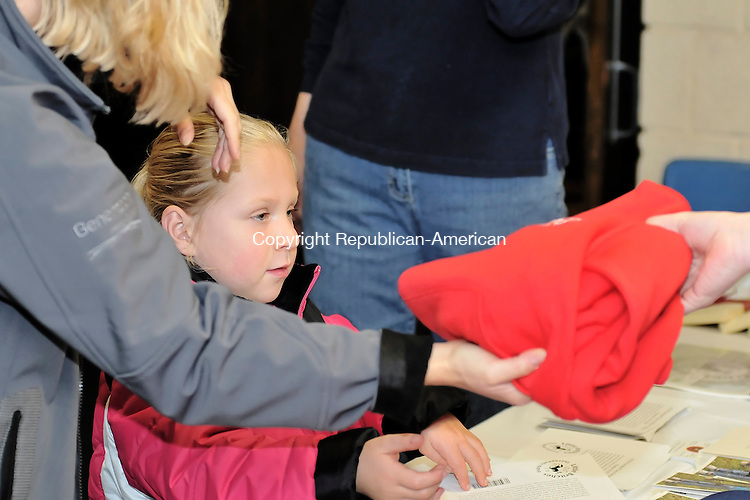 WOODBURY, CT-18 OCTOBER 2009-101809JS05- Brittney Wheeler, 5, of Southbury and her mother Lisa Wheeler, purchases a sweatshirt during the Little Britches Therapeutic Riding Program's Fall Festival and Vendors Show held Sunday at Nonnewaug High School in Woodbury.  <br /> Jim Shannon Republican-American
