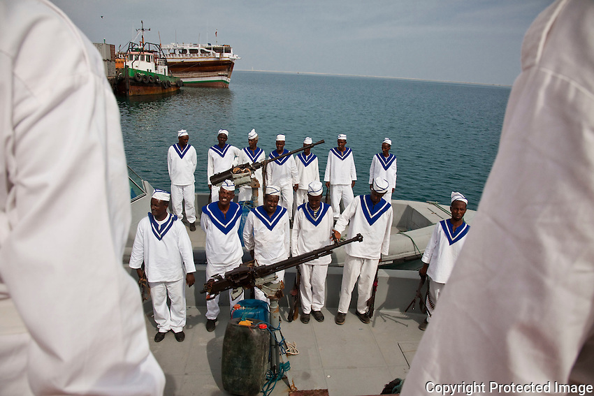 Somaliland Coast Guard standing at attention for thier commanders prior to an anti-piracy patrol on the  sea near Berbera, Somaliland, Somalia