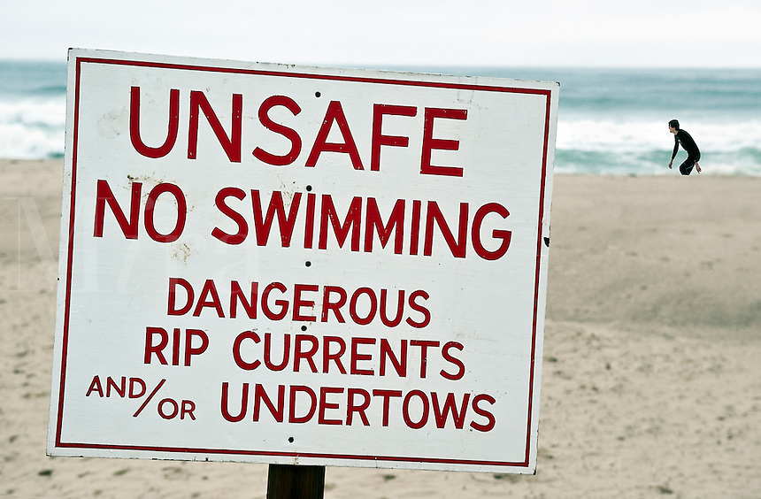 Unsafe to swim sign at the beach.