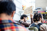 "Protesters gather en masse to march to the Brooklyn Bridge as ""Occupy Wall Street"" hits its two week anniversary in Zuccotti Park in New York City on October 1, 2011."