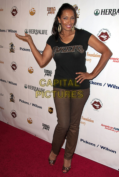 KATHLEEN BRADY.K.I.S. Foundation celebrates the 100th discovery year of Sickle Cell Disease with their Annual Bowling Challenge held at PINZ Entertainment  Center, Studio City, CA, USA..September 17th, 2010.full length black t-shirt brown trousers hand on hip posing .CAP/ADM/DT.©Daniel Tanner/AdMedia/Capital Pictures.