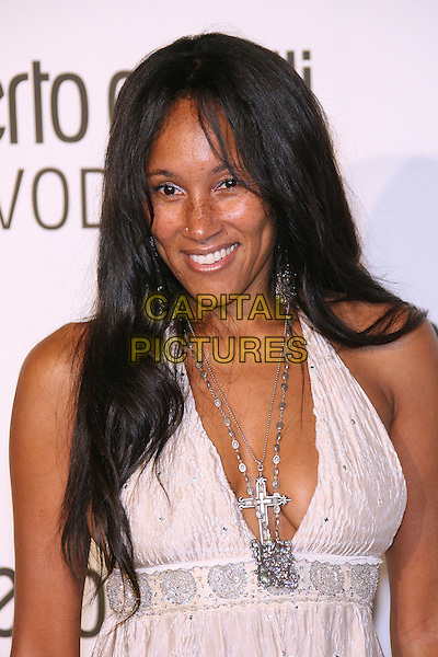 CYNTHIA GARRETT.Roberto Cavalli Vodka Launch Party held at a private residence, Holmby Hills, California, USA..May 11th, 2006.Photo: Zach Lipp/AdMedia/Capital Pictures.Ref: ZL/ADM.headshot portrait silver necklaces.www.capitalpictures.com.sales@capitalpictures.com.© Capital Pictures.